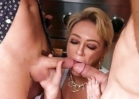 Drooling busty blonde getting spit-roasted by two hung dudes