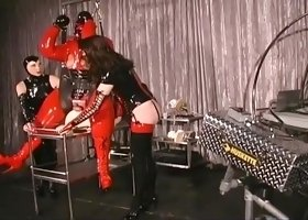 Fat Man In Latex Sits On The Sybian