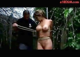 Busty Girl Getting Tied To Pole In The Garden Spanked With Stick Fingered By Master