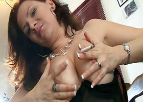Hot milf shows off her tits while smoking in solo clip