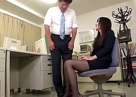 Kinky foot fetishist worships her nylon clad legs in the office