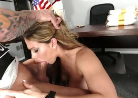 A pretty lady that loves cock is sucking policeman's large dick