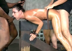 Oiled up milf India Summer shackled down and fucked hard