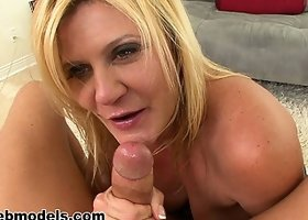 Ginger Lynn takes his cock in her mouth while fondling her tits