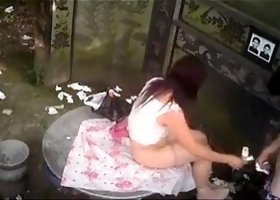 Amateur Asian babe gets drilled by her man in a public place