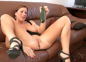 Huge breasted Katherine hammers her vagina with a cucumber