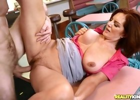 A sex mad guy seduces redhead older woman with big natural boobs