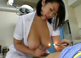 Busty nurse gives an incredible Asian handjob and titjob