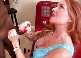 Milf redhead strokes BBC until he nuts in her cleavage
