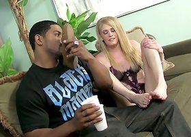 A cute blonde gets her toes licked by a Black guy